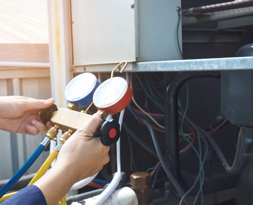 hands shown holding a device to check on the hvac system